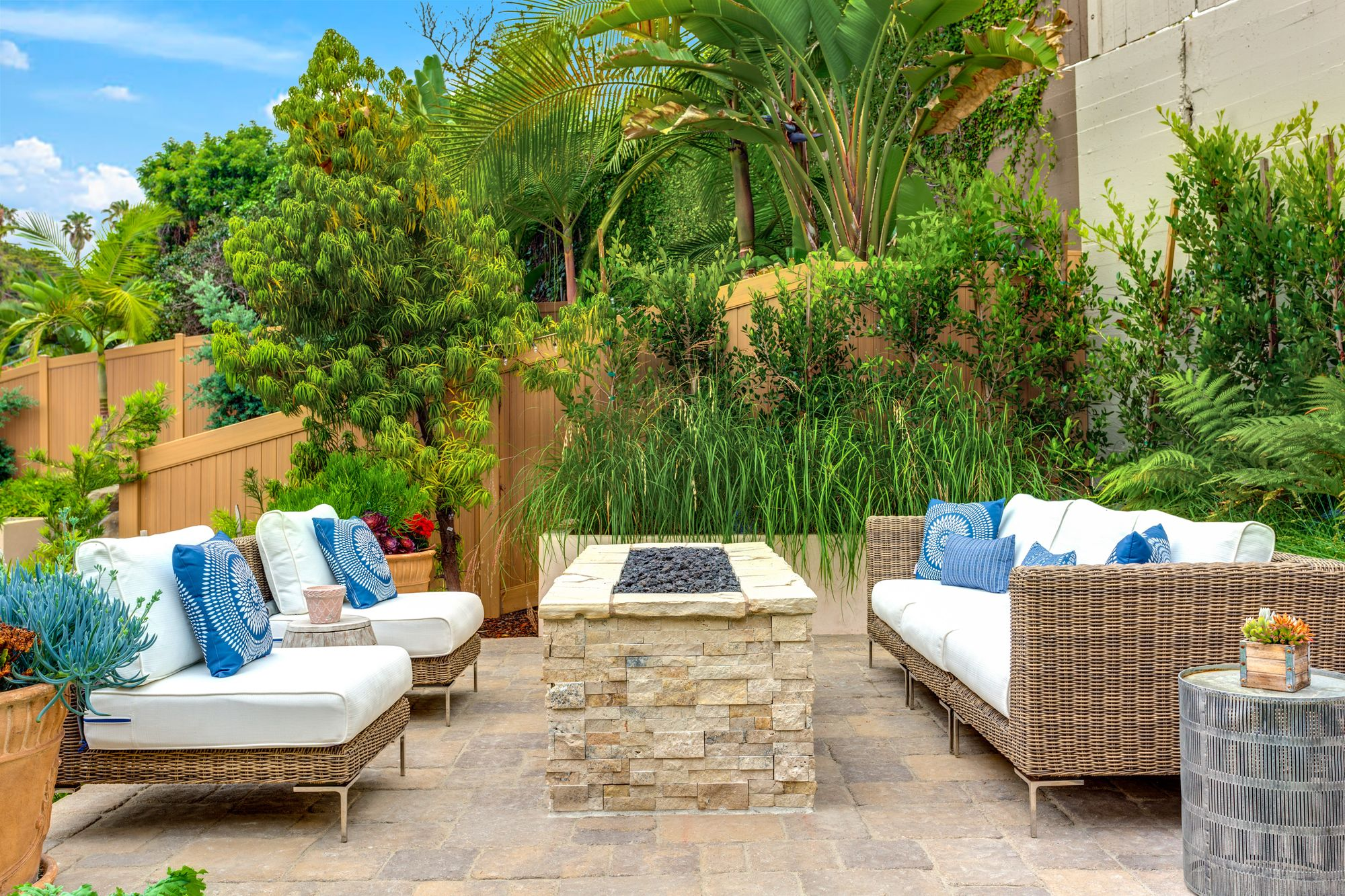 outdoor sofa next to a glass crystal fire pit