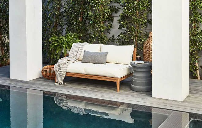 Teak outdoor furniture with white cushions