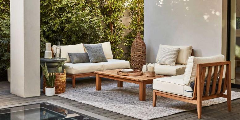 teak outdoor furniture set up by pool
