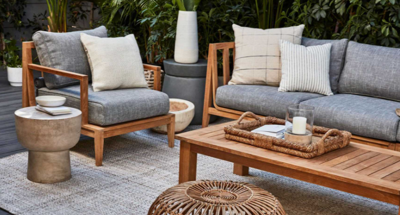 Teak outdoor furniture with grey cushions