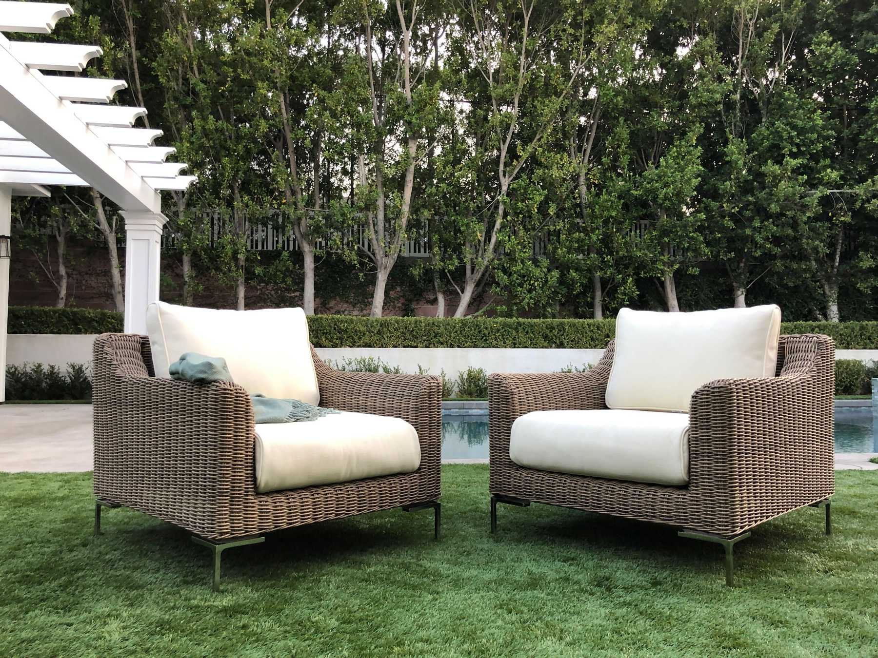 Two patio chairs pool side