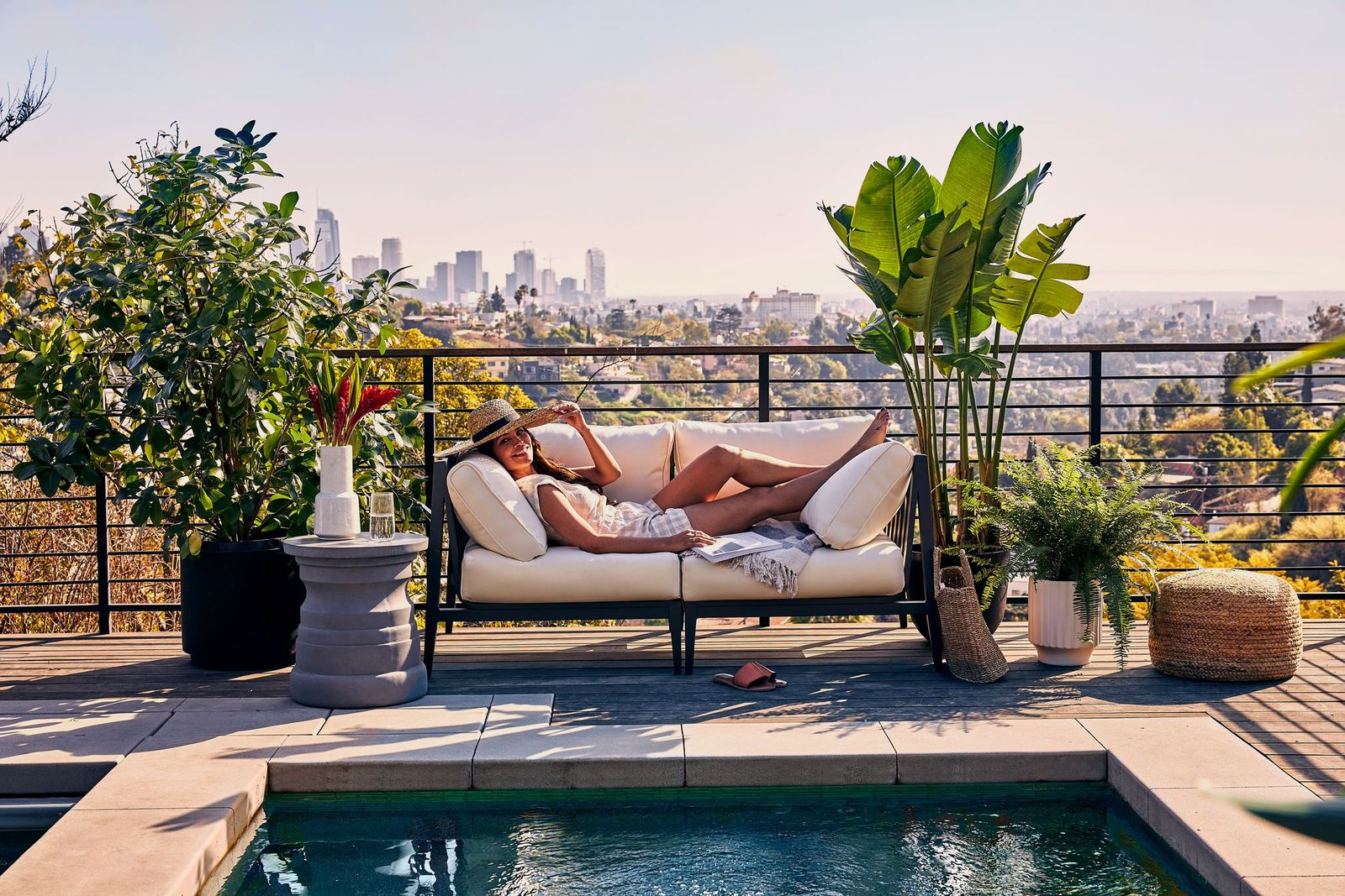 Woman lounging by the pool on aluminum outdoor furniture