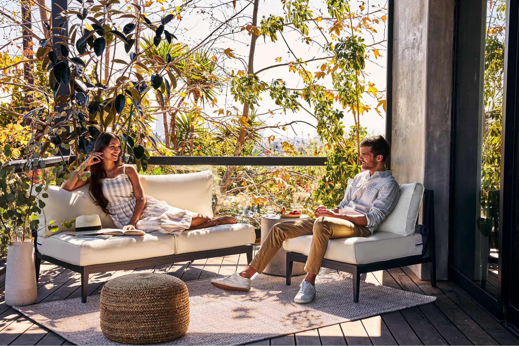 Two people hanging out on aluminum outdoor furniture