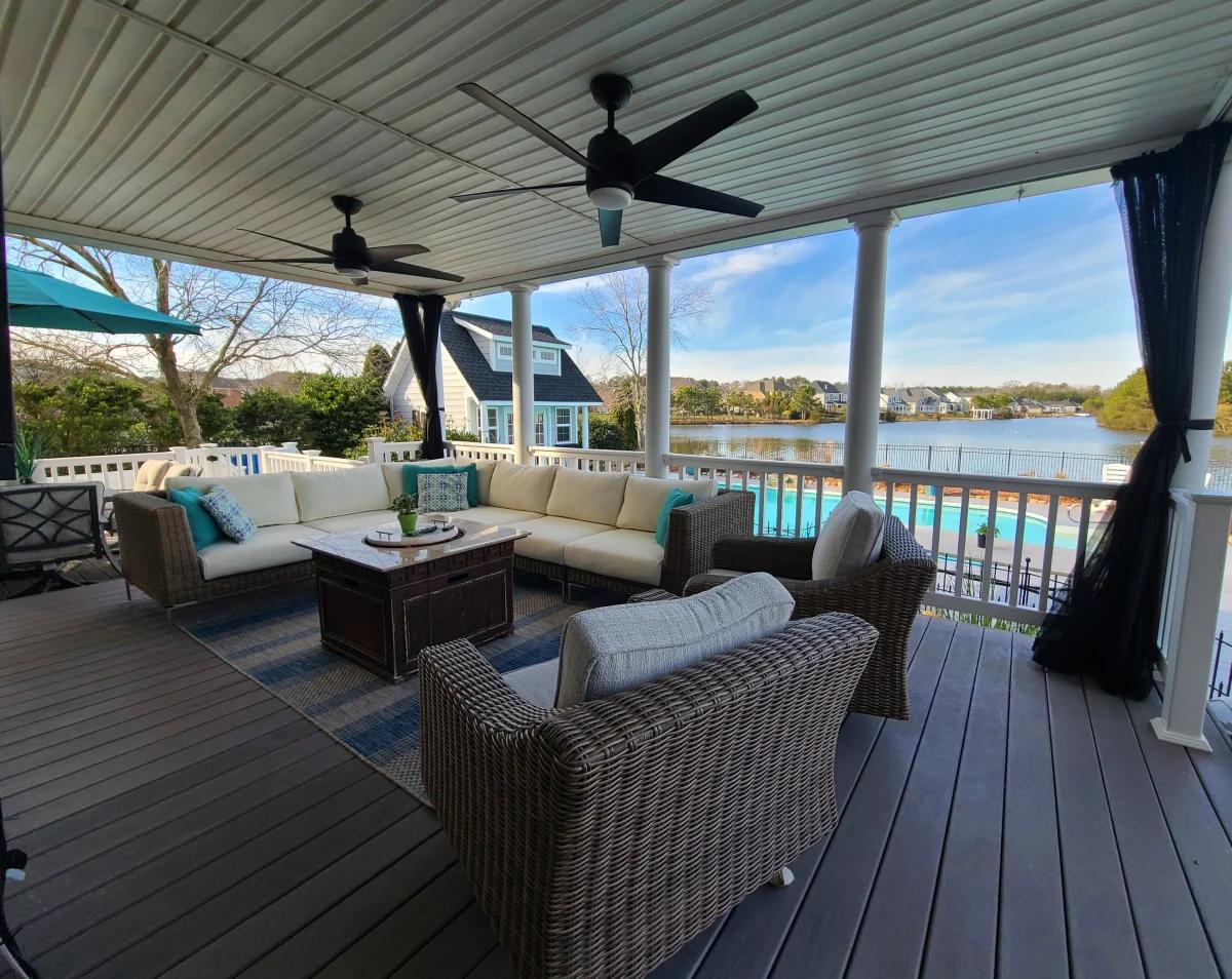 Deck furniture overlooking the backyard pool