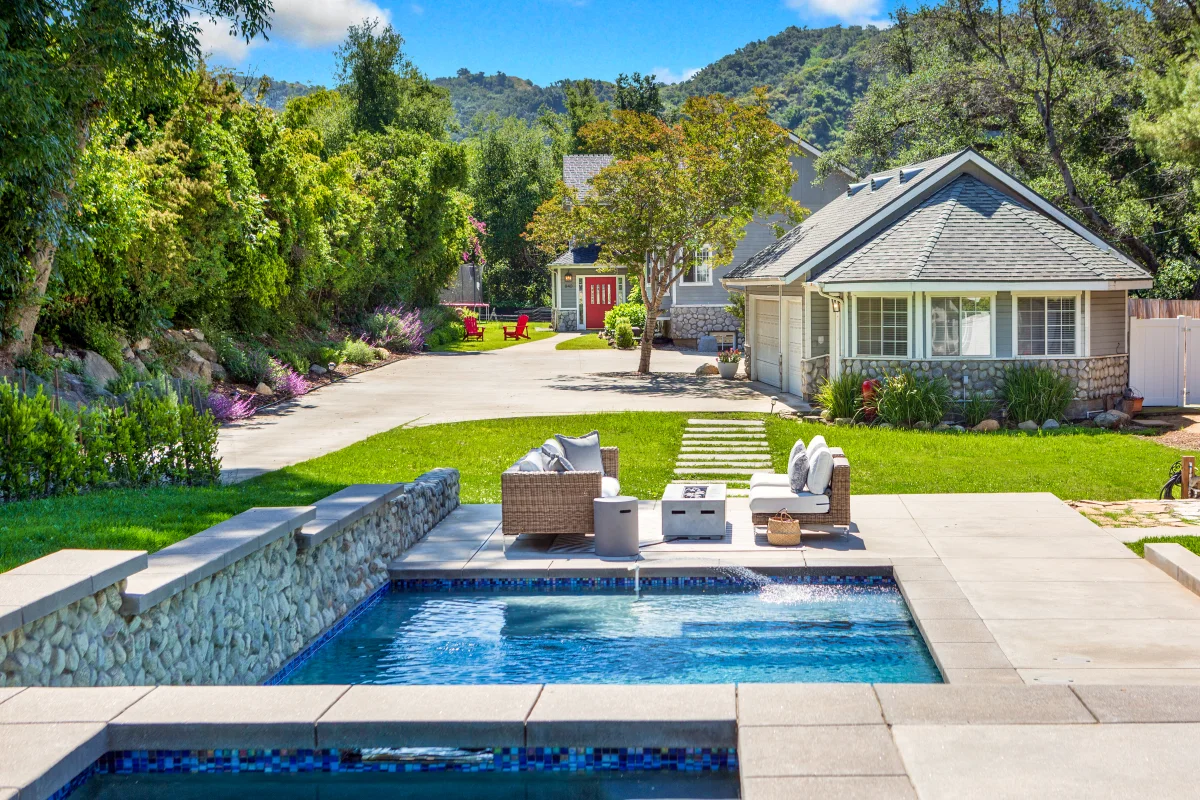 Outdoor space with pool and spa
