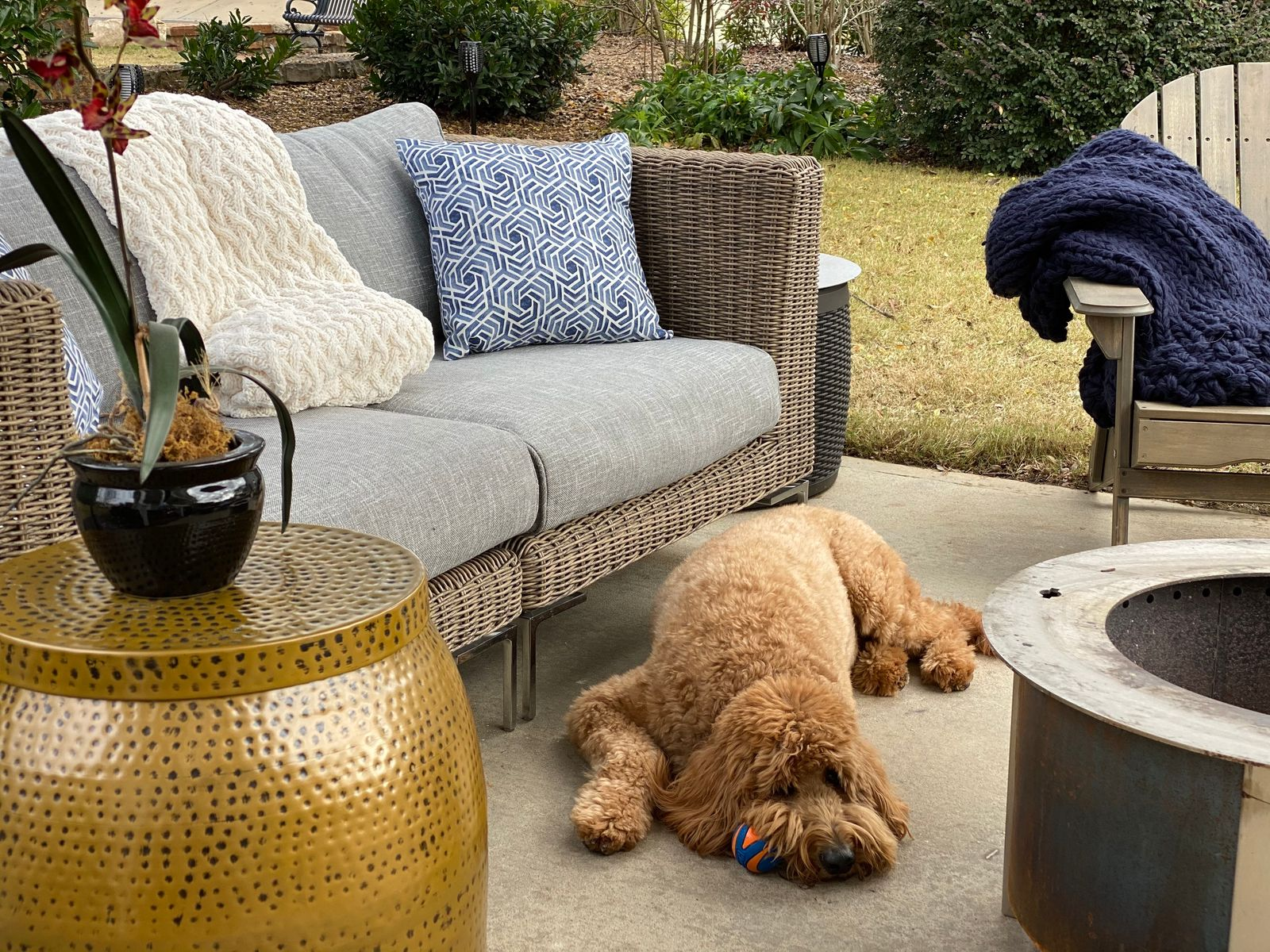 backyard ideas with wicker furniture and a fire pit