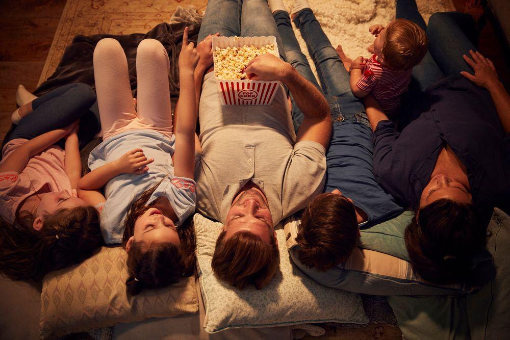 Family having a backyard movie night