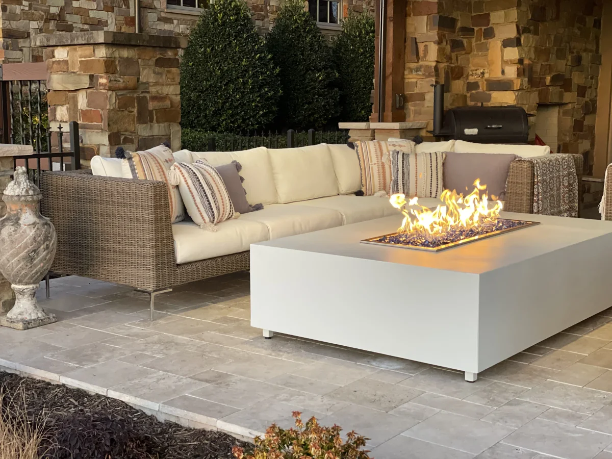white patio furniture with a fire pit