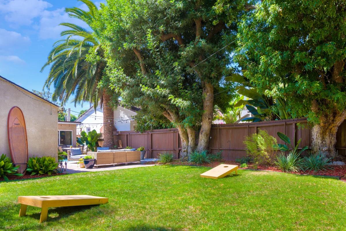 Corn hole boards set up near outdoor patio furniture set