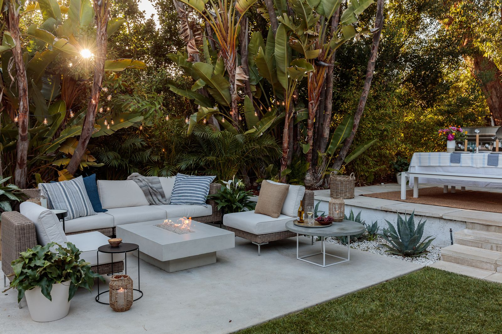 Neutral garden furniture with a glass fire pit