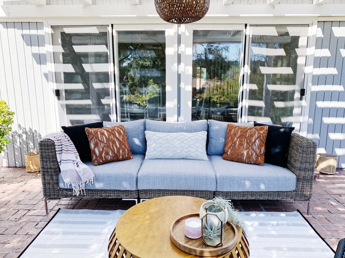 wicker modular outdoor furniture with blue cushions