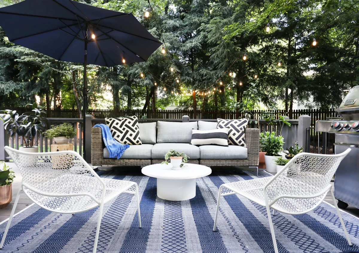 outdoor wicker furniture on a blue stripped outdoor rug