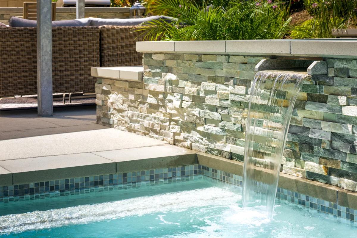 backyard oasis with a pool water fall