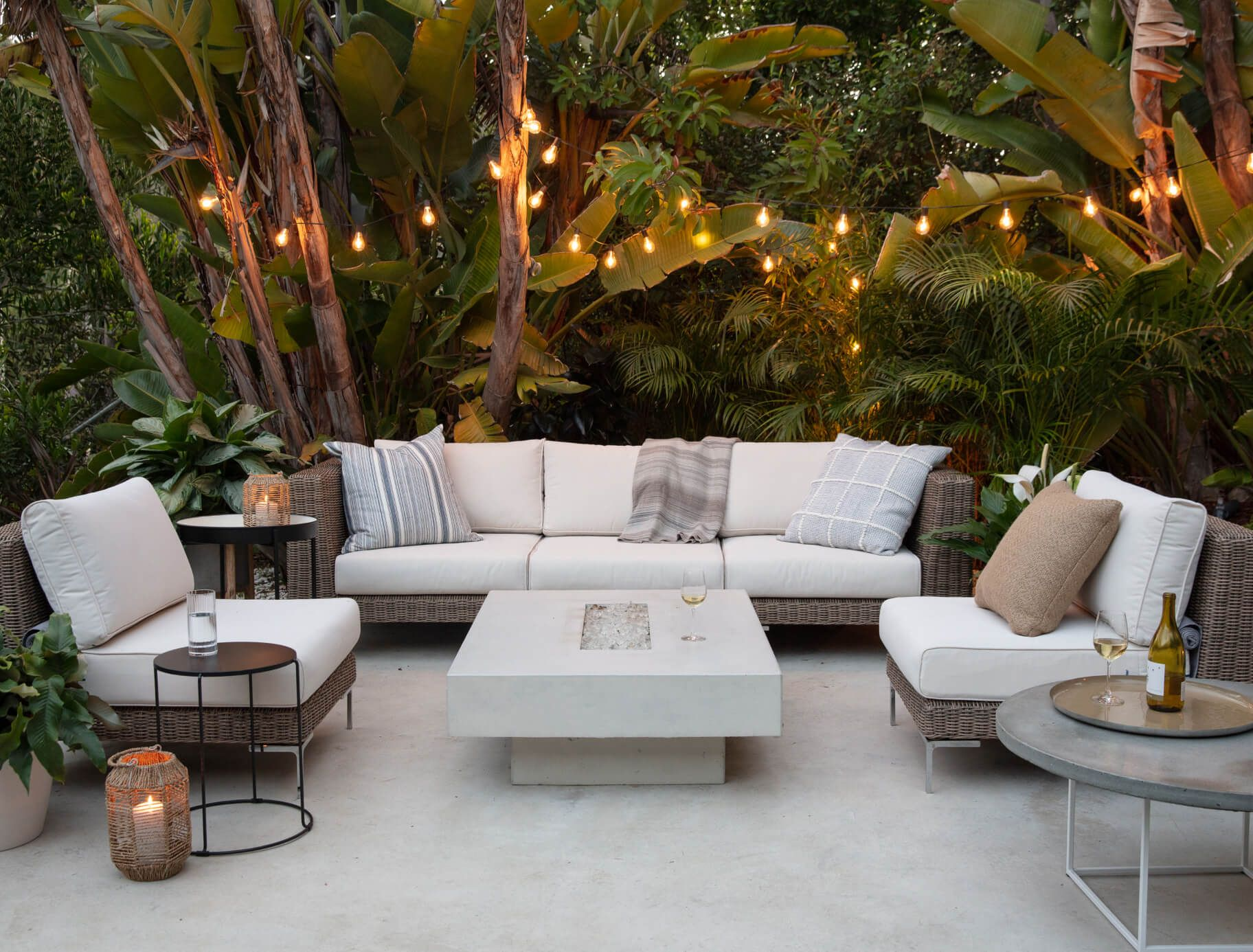 White outdoor furniture with a glass fire pit