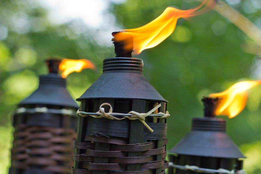 Tiki torches are a great solution for how to keep mosquitos away