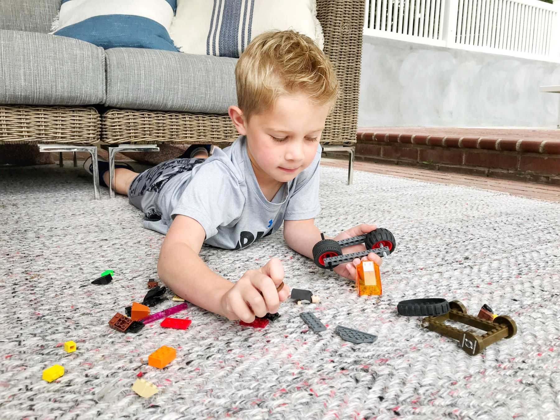 Boy playing on indoor outdoor carpet