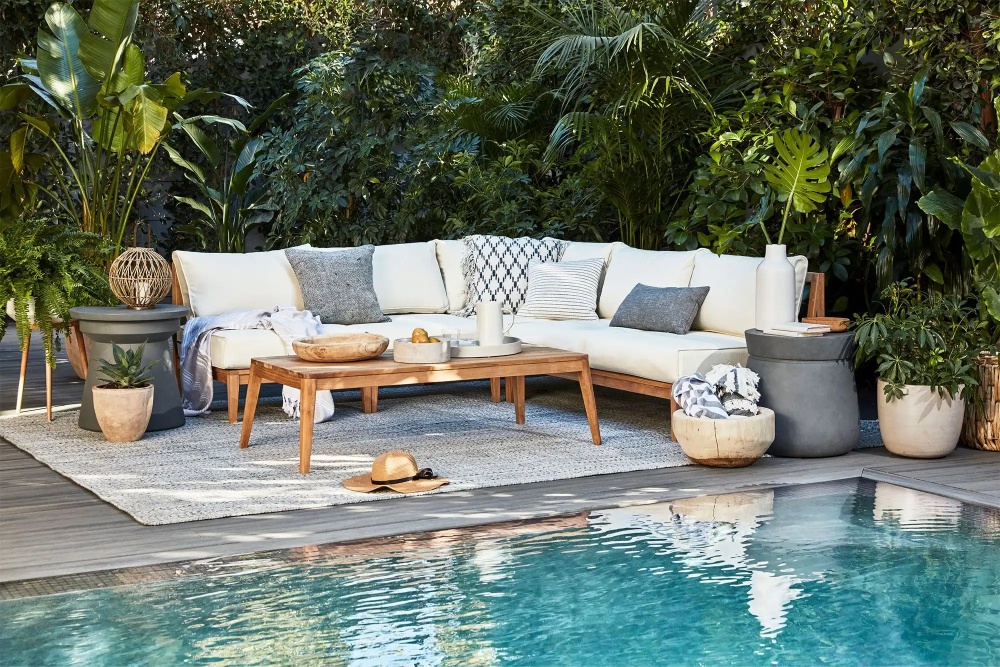 outdoor coffee table near a pool