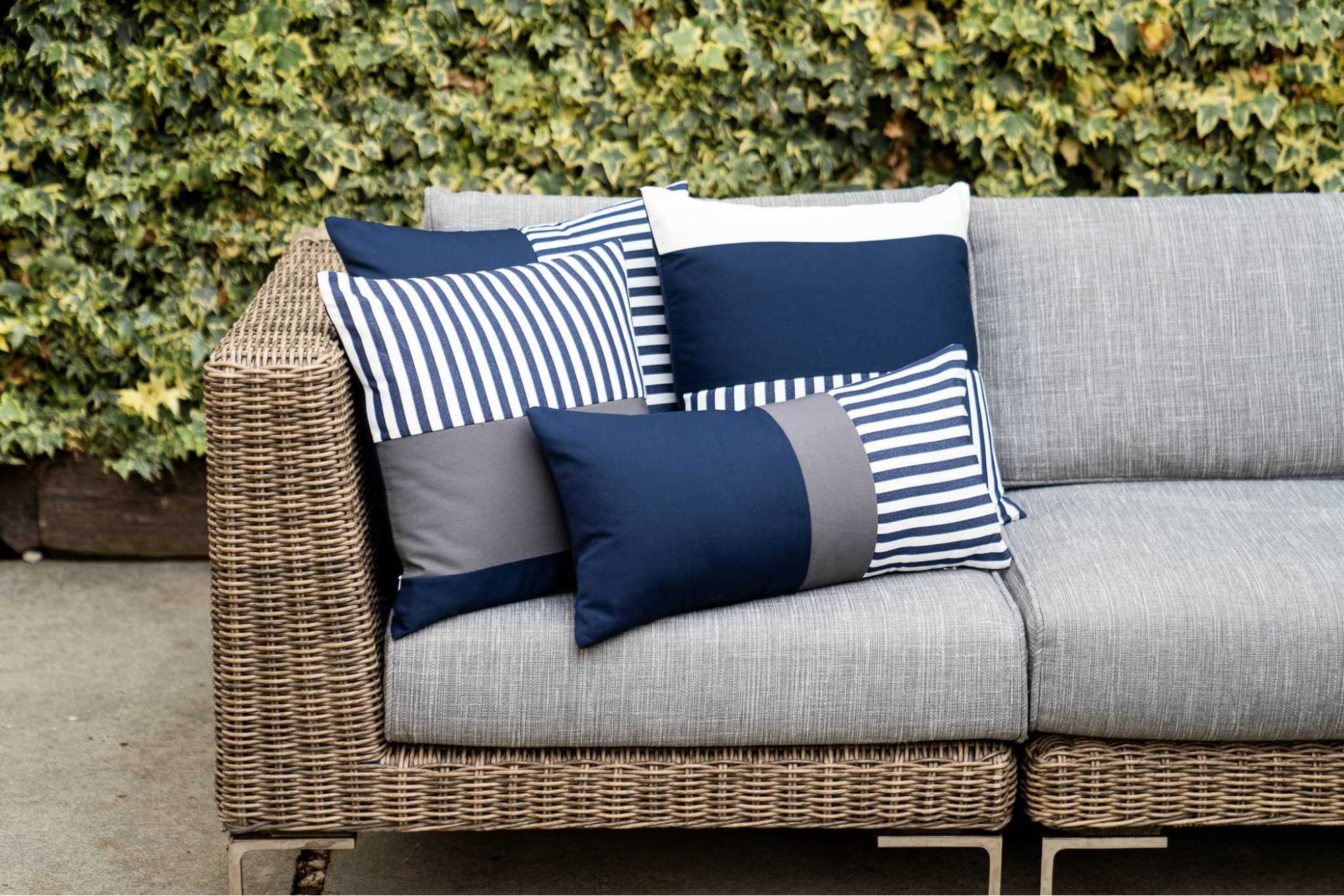 outdoor cushions on a wicker couch