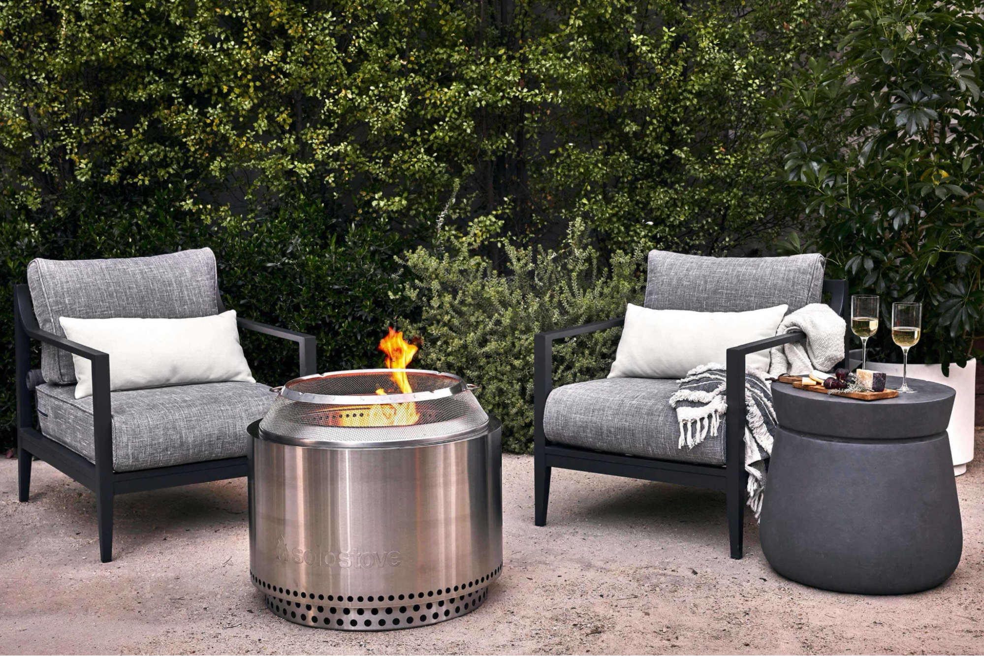 patio chairs next to a fire