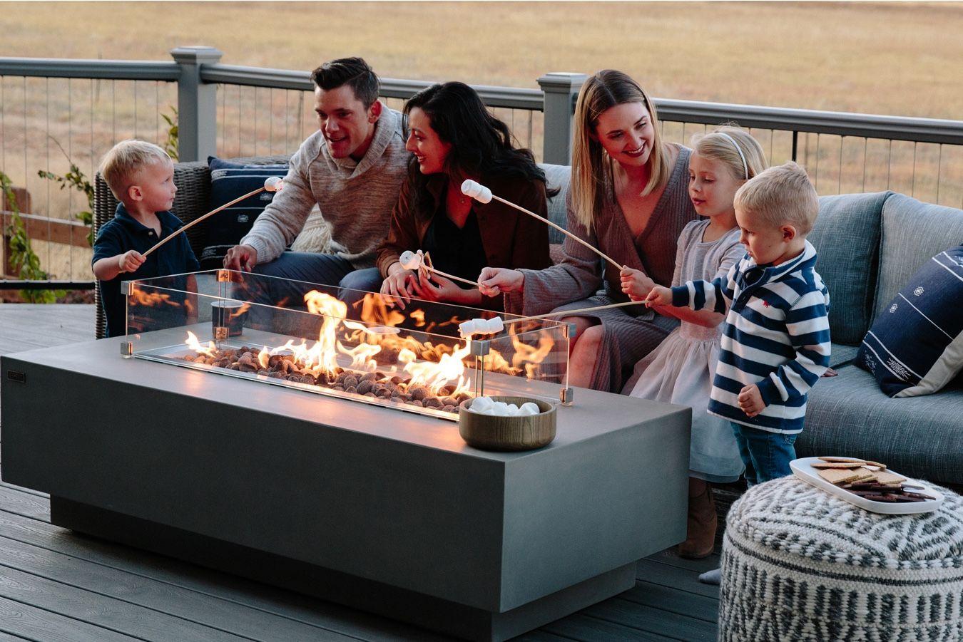 Family making smore's in backyard bonfire
