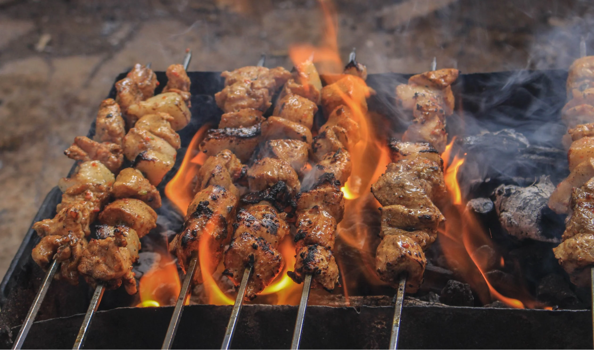 The Complete Fire Pit Grill Buying Guide, Plus Expert Grilling Tips