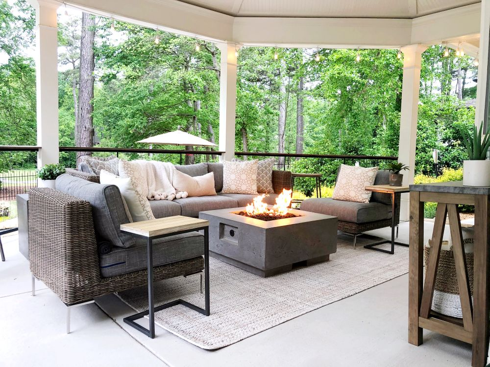Wicker outdoor furniture surrounding a fire pit