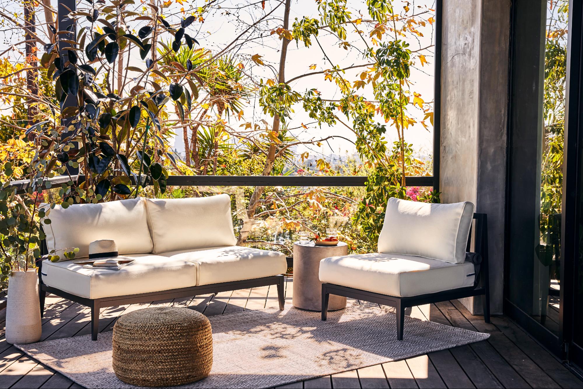 Aluminum outdoor furniture on top of an outdoor rug