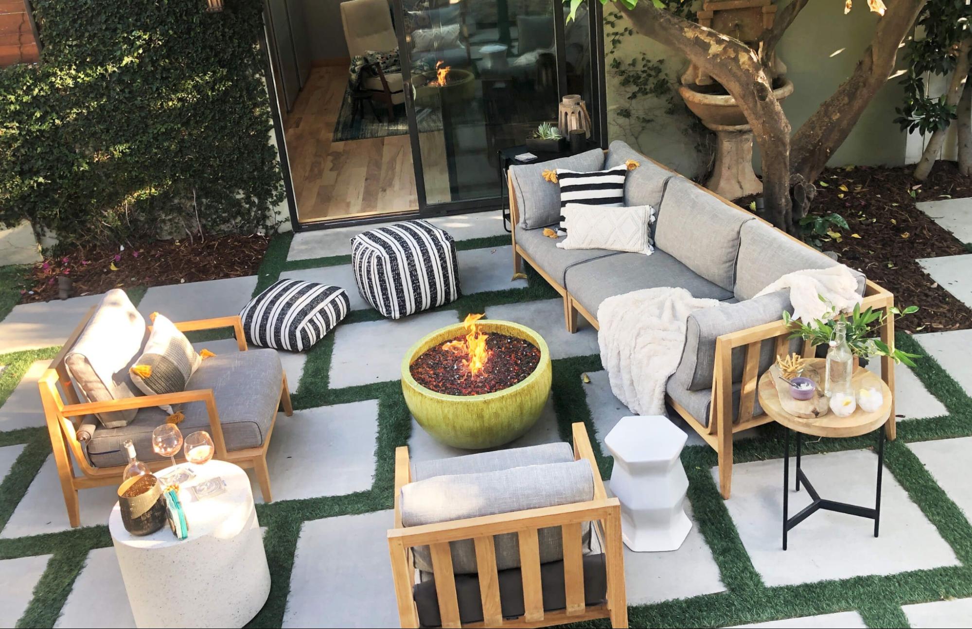 Teak outdoor furniture surrounding a fire pit
